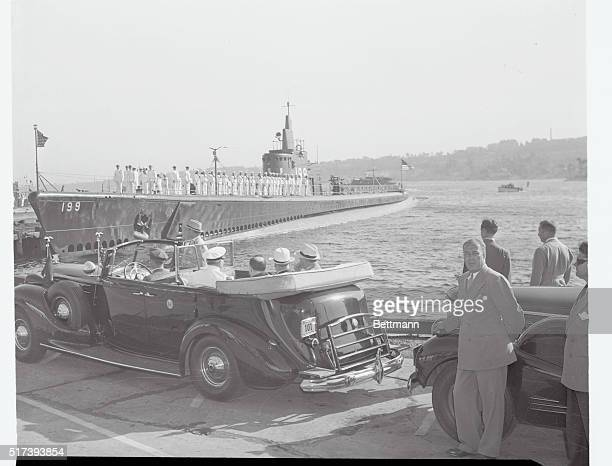 Completing a tour of seven New England defense projects President Franklin D Roosevelt in rear seat of car right is shown at Groton Plant of the...