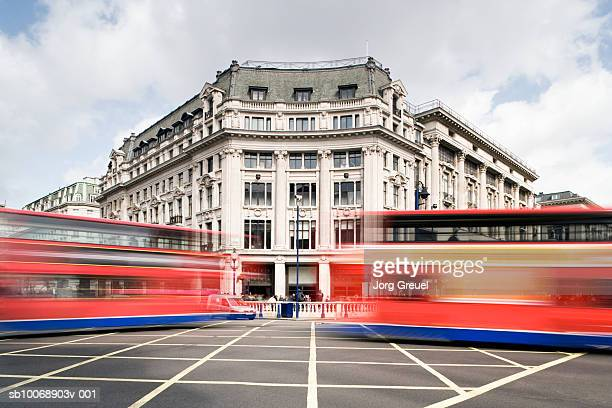 UK, London, double-decker buses at Oxford Circus, blurred motion