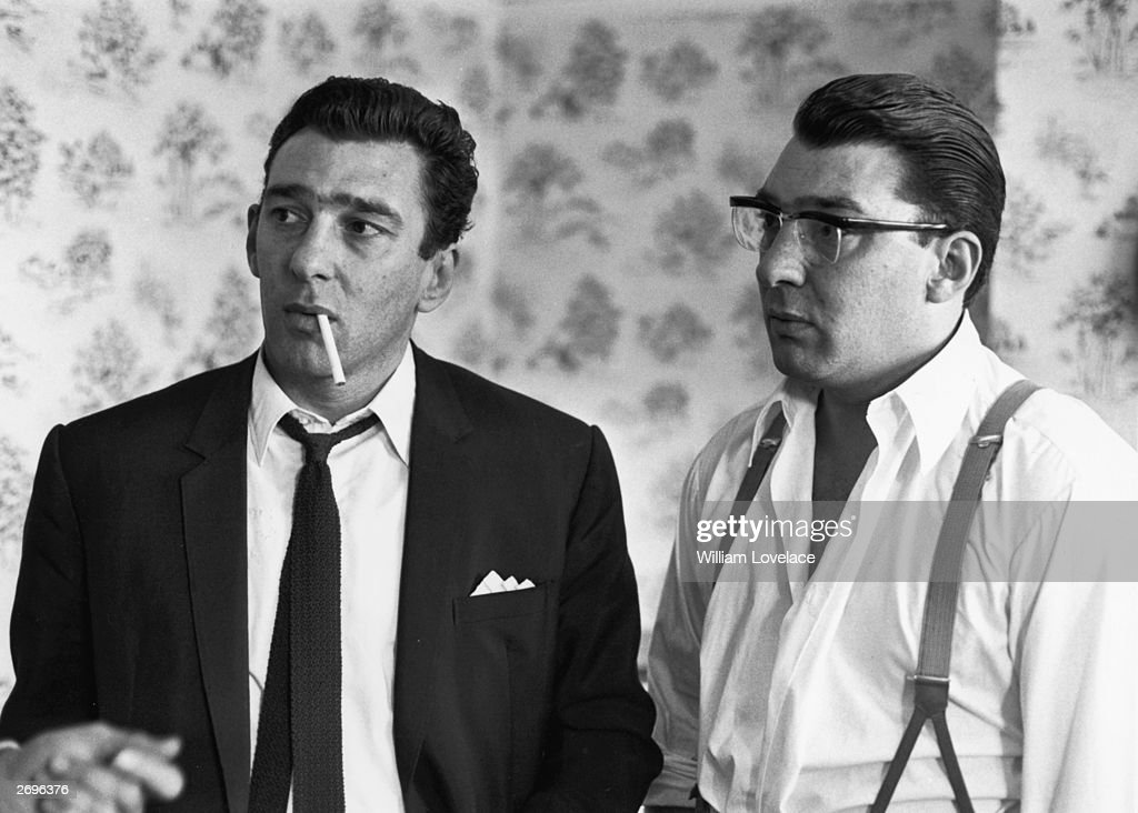 London East End gangster twins Ronnie (right) and Reggie Kray pictured after spending 36 hours helping the police with their inquiry into the murder of George Cornell. They were found guilty of murder in 1969 after a trial at the Old Bailey.