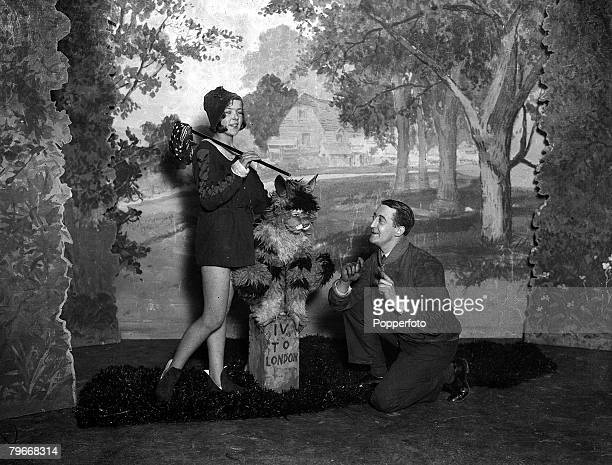 London England 10th December Stanley Lupino rehearses his daughters Ida Lupino who plays Dick Whittington and Rita as the cat in the miniature...