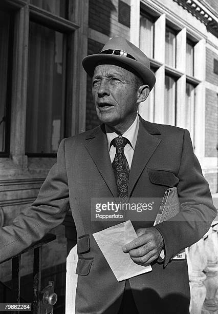 London England 10th March 1971 American singer and film star Bing Crosby carries a newspaper and a letter during a private visit to the capital