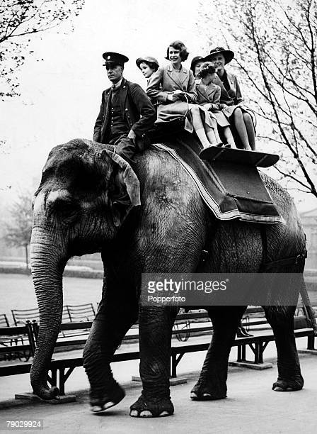 London England 10th May 1939 Princess Elizabeth and Princess Margaret enjoy an Elephant ride during a visit to London Zoo