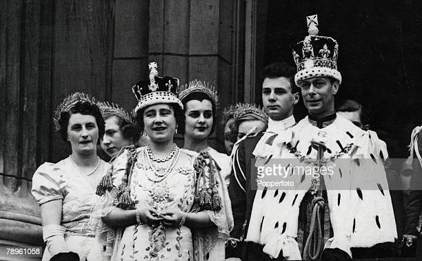 London England 12th May 1937 King George VI and Queen Elizabeth pictured wearing their crowns and coronation robes as they stand on the balcony of...