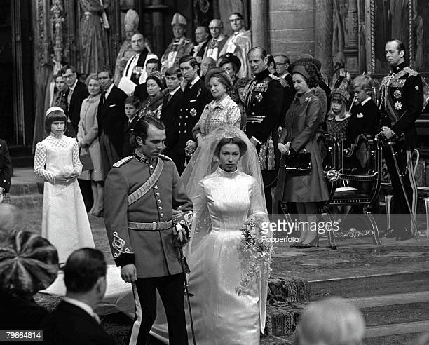 London England 14th November HRH Princess Anne and captain Mark Phillips walk past members of the Royal family after their wedding service at...