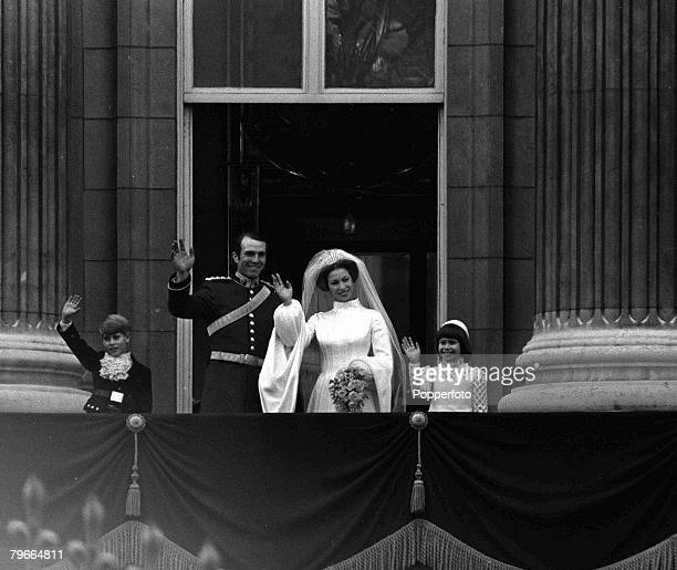London England 14th November HRH Princess Anne and captain Mark Phillips wave to the crowd from the Buckingham Palace balcony aftre their wedding at...