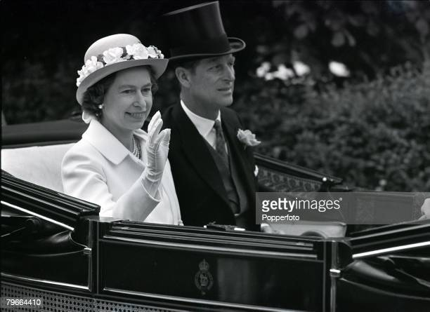 London England 16th June 1971 Her Majesty Queen Elizabeth II waves as she sits with her husband Prince Philip the Duke of Edinburgh as she arrives at...