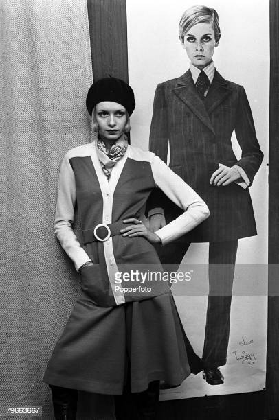 London England 18 January 1968 British Fashion model Twiggy wearing a jersey cardigan with culottes and long boots stands beside a lifesize...