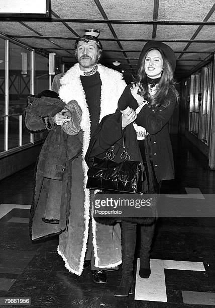 London England 19th January 1971 Irish actor Richard Harris is pictured at Heathrow with model girlfriend Chris Rudas as they left for a three week...