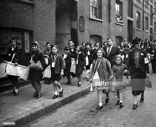 London England 1st September Children walking down the street arm in arm as they hurry to the railway station to catch a train for evacuation into...