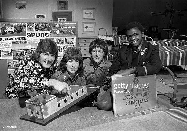 London England 30th December 1971 BBC TV 'Blue Peter' stars LR Peter Purves Valerie Singleton John Noakes pictured in the studio with a young African...