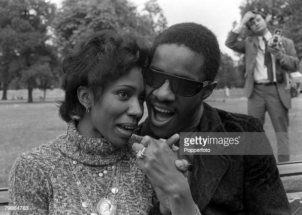 London England 30th June Blind American pop singer and composer Stevie Wonder pictured in London with his fiancee singer and lyricist Syreeta Wright...