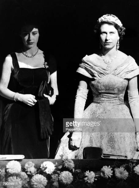 London England 3rd November 1952 Queen Elizabeth II and Princess Margaret stand in the Royal Box at the London Palladium where they attended the...