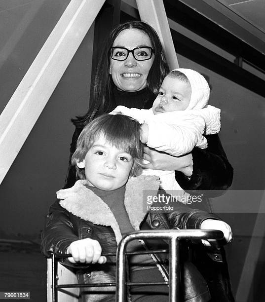 London England 7th January 1971 Greek singer Nana Mouskouri is pictured at Heathrow with her children Helene and Nicholas