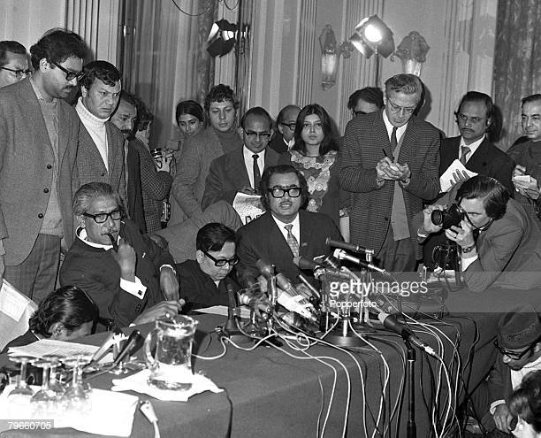 London England 8th January 1972 Sheikh Mujibur Rahman the 'Father of Bangladesh' puffs on his pipe at a London press conference shortly after his...