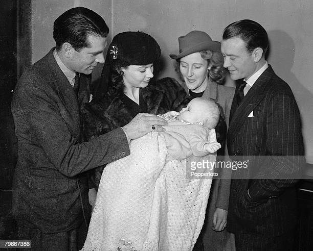 London England 9th April British film actor John Mills pictured with his wife and baby daughter Juliette being held by godmother Vivien Leigh and...