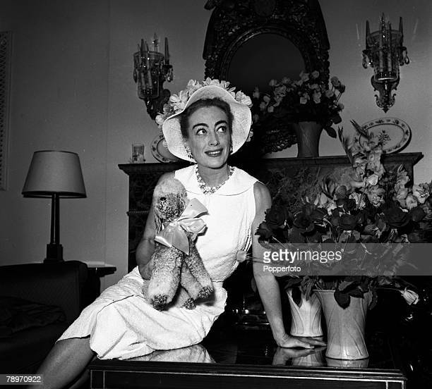 London England American actress Joan Crawford is pictured at a press reception at the Savoy Hotel
