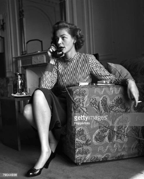 London England American actress Lauren Bacall is pictured on the telephone at the Savoy Hotel