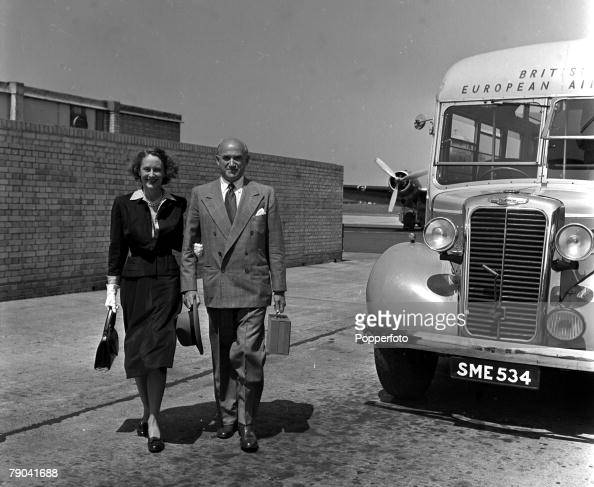 London England American film producer Sam Goldwyn and his wife Frances are pictured leaving Northolt Airport