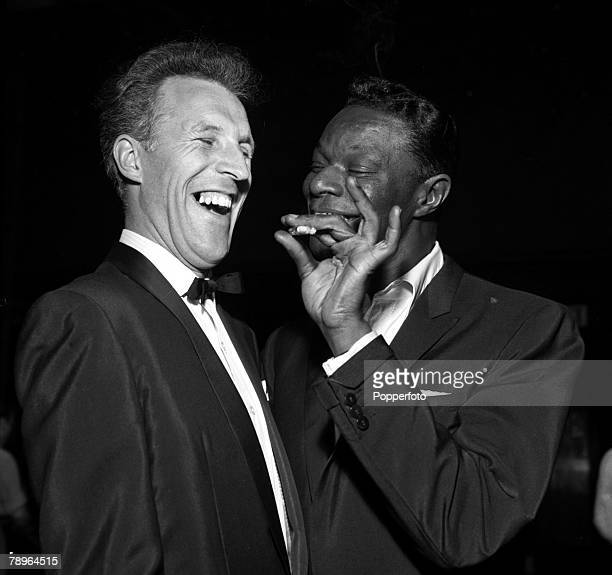 London England ATV's 'Sunday Night Show' American singer Nat 'King' Cole is pictured with entertainer Bruce Forsyth