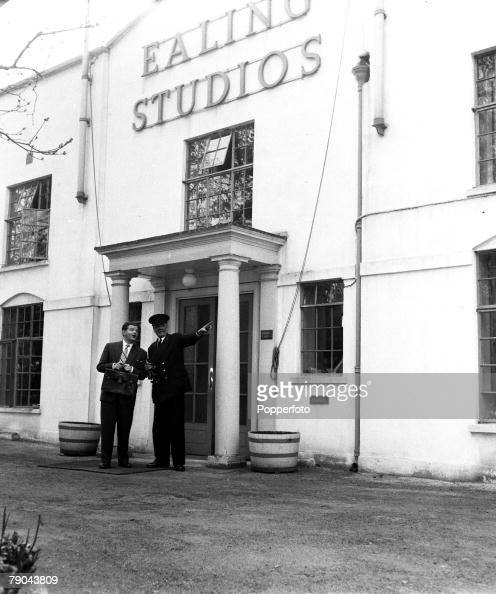 London England British actor and comedian Benny Hill is pictured with the commissionaire during his first day on a film set at the Ealing studios