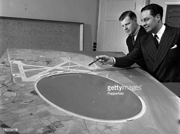 London England Mr FG Miles and architect Guy Morgan inspect the proposed model for the new London Airport at a London meeting
