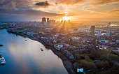 London, England - Panoramic aerial skyline view of east London at sunrise with skycrapers of Canary Wharf and beautiful colorful sky at background