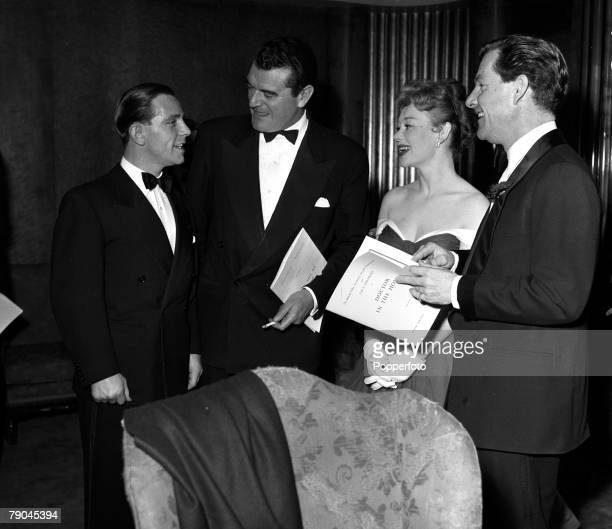 London England Pictured at the British Film Academy Awards at the Odeon Cinema Leicester Square are LR Norman Wisdom Jack Hawkins Glynis Johns and...