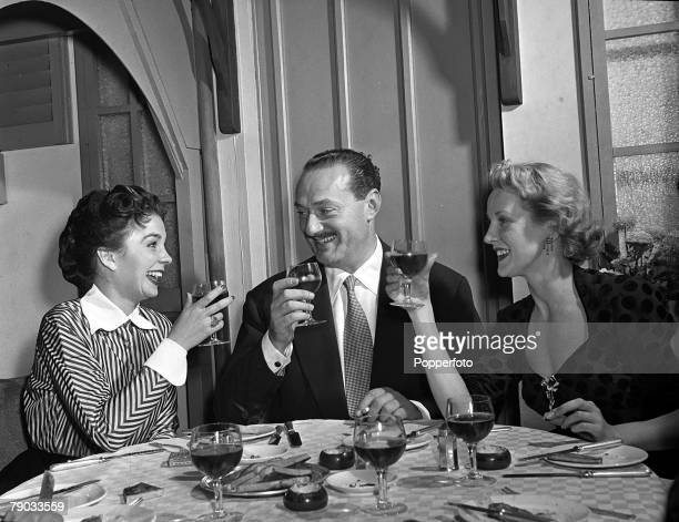 London England Pictured enjoying dinner at the Bon Viveur Club are LR Actress Jean Simmons Mayfair club owner John Mills and actress Anne Crawford