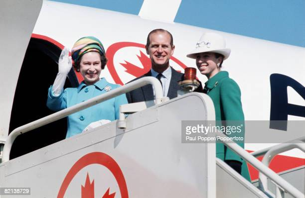 London England Queen Elizabeth II of Great Britain is pictured with Prince Philip the Duke of Edinburgh and Princess Anne as they prepare to depart...