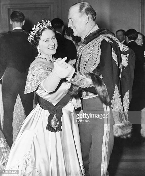 London England Queen Mother Elizabeth is shown dancing with Hussar Colone Combe at the Balaclava Ball in London Her daughter Queen Elizabeth II was...