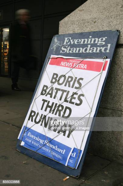 A London Evening Standard newspaper advertising board outside Westminster underground station in London
