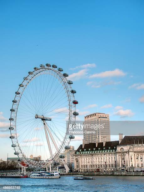 London Eye ferris wheel in front of former County hall England United Kingdom