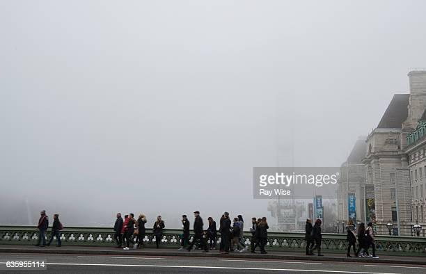 London Eye in fog from Westminster Bridge.