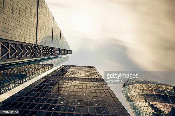UK, London, facades of office towers at financial district seen from below
