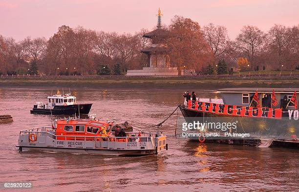 A London Fire Brigade Fire Rescue boat comes to inspect a pound5 million punk collection belonging to Joe Corre the son of Vivienne Westwood and Sex...