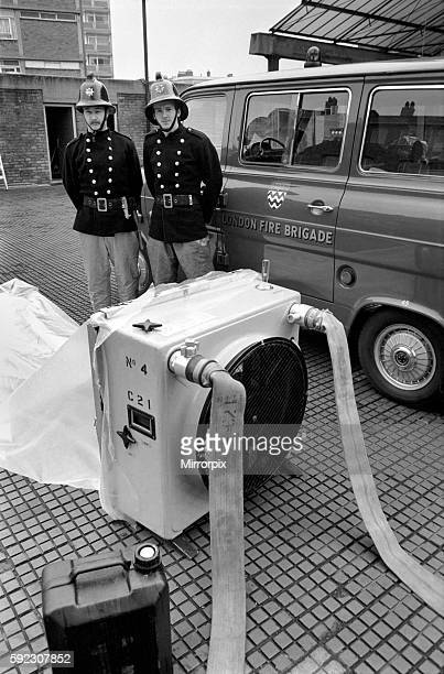 London Fire Brigade's new highexx unit with firemen Leading fireman Hall and Fireman Looney at Old Street Fire Station EC March 1975 7501572005