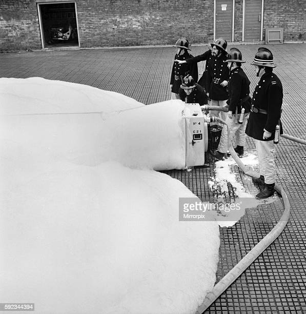 London Fire Brigade's new highexx unit with firemen Leading fireman Hall and Fireman Looney at Old Street Fire Station EC March 1975 7501572001