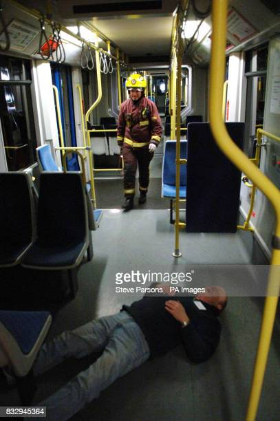 A London firefighter checks searches a carriage in a crashed tram during a training exercise in Croydon South London
