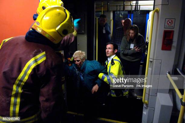 London firefighters and Metropolitan police assist models pretending to be survivors in a crashed tram during a training exercise in Croydon South...