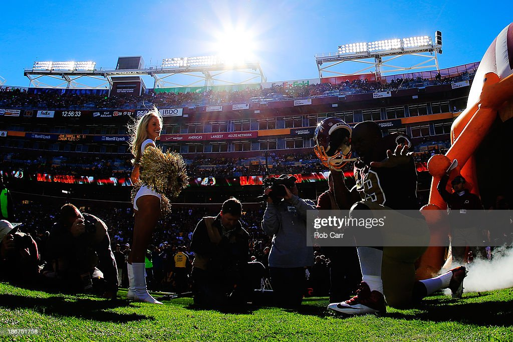 <a gi-track='captionPersonalityLinkClicked' href=/galleries/search?phrase=London+Fletcher&family=editorial&specificpeople=223941 ng-click='$event.stopPropagation()'>London Fletcher</a> #59 of the Washington Redskins is introduced before the start of the Redskins and San Diego Chargers game at FedExField on November 3, 2013 in Landover, Maryland.