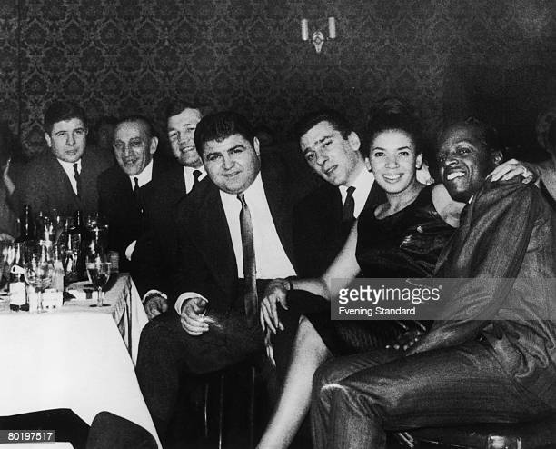 London gangster Reggie Kray at a nightclub with friends including Welsh singer Shirley Bassey circa 1965