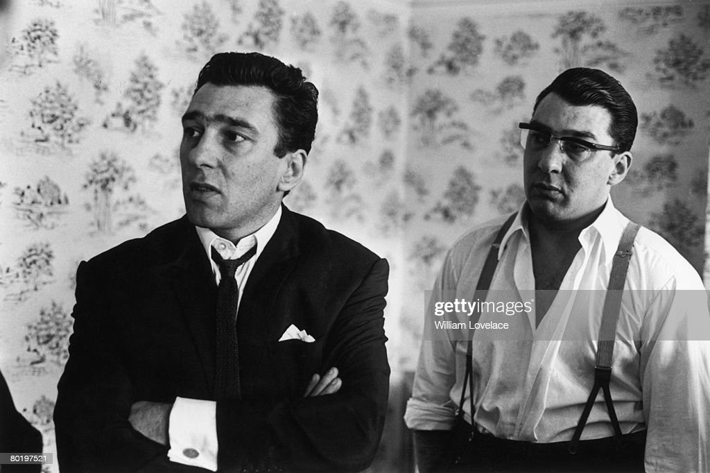 London gangsters the Kray twins, Reggie (1933 - 2000, left) and Ronnie (1933 - 1995) after spending 36 hours helping the police with their inquiry into the murder of George Cornell, 6th August 1966. They were found guilty of murder in 1969 after a trial at the Old Bailey.