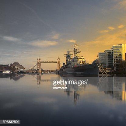 UK, London, HMS Belfast and Tower Bridge seen from water line
