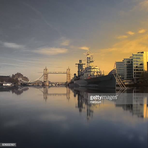 UK, London, HMS Belfast and Tower Bridge seen from water line