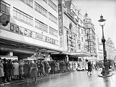 Everyday Life In London England A busy scene in London's Leicester Square as civilians and service personnel queue for admission to the Empire and...