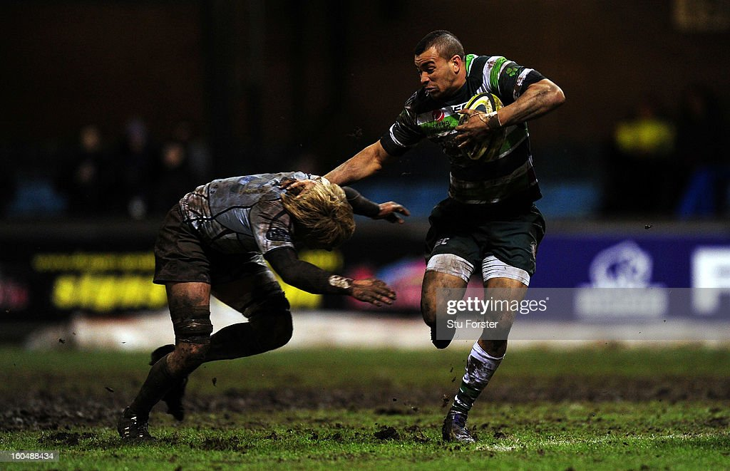 London Irish player Jonathan Joseph (r) makes a break during the LV= Cup match between Cardiff Blues and London Irish at the Arms Park on February 1, 2013 in Cardiff, Wales.