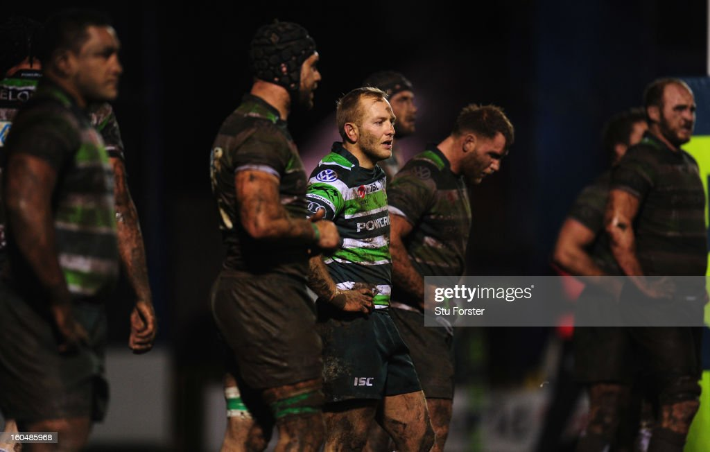 London Irish player <a gi-track='captionPersonalityLinkClicked' href=/galleries/search?phrase=Shane+Geraghty&family=editorial&specificpeople=697734 ng-click='$event.stopPropagation()'>Shane Geraghty</a> (c) stays clean amongst the Irish forwards covered in mud during the LV= Cup match between Cardiff Blues and London Irish at the Arms Park on February 1, 2013 in Cardiff, Wales.