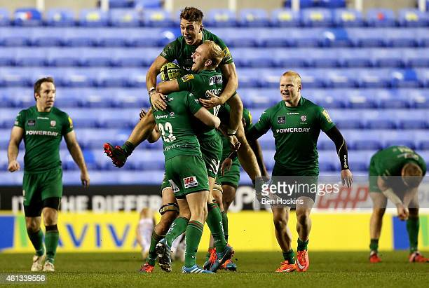 London Irish players celebrate with Shane Geraghty after he kicks the winning points with a drop goal during the Aviva Premiership match between...