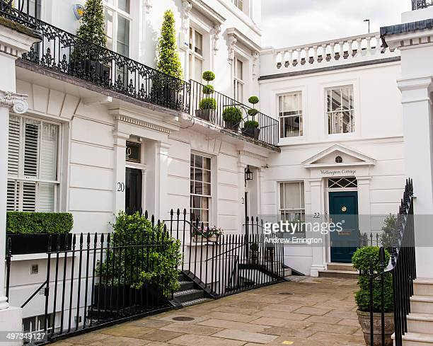 London Knightsbridge front of houses decorated with box plants