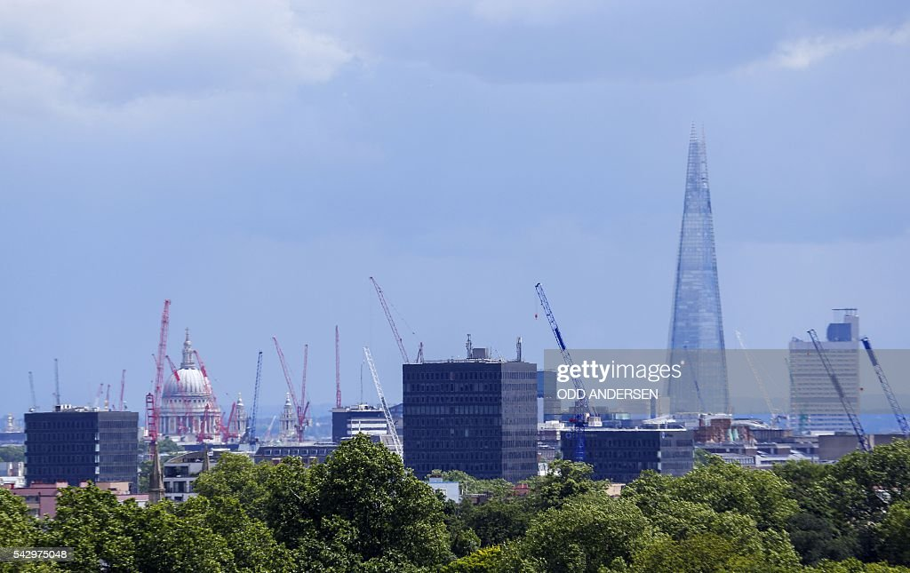 London landmarks, including the St Paul's Cathedral and the Shard are pictured with construction cranes on the skyline, from Primrose Hill in north London on June 25, 2016, after the announcement that the UK had voted on June 23 to leave the European Union in a national referendum. The result of Britain's June 23 referendum vote to leave the European Union (EU) has pitted parents against children, cities against rural areas, north against south and university graduates against those with fewer qualifications. London, Scotland and Northern Ireland voted to remain in the EU but Wales and large swathes of England, particularly former industrial hubs in the north with many disaffected workers, backed a Brexit. / AFP / Odd ANDERSEN